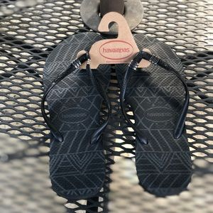 NWOT Black & Silver Havaianas flip flops.